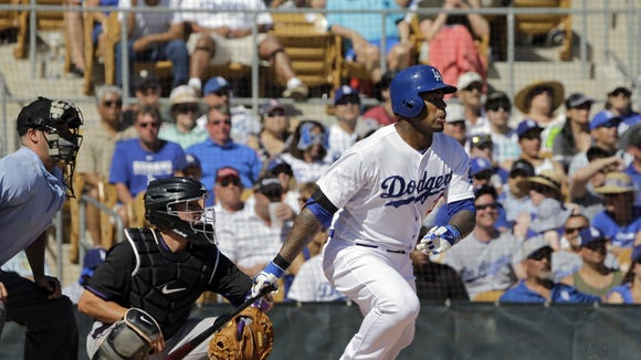 Los Angeles Dodgers' Carl Crawford singles against the Colorado Rockies in a spring exhibition baseball game Sunday, March 16, 2014, in Glendale, Ariz. (AP Photo/Mark Duncan)
