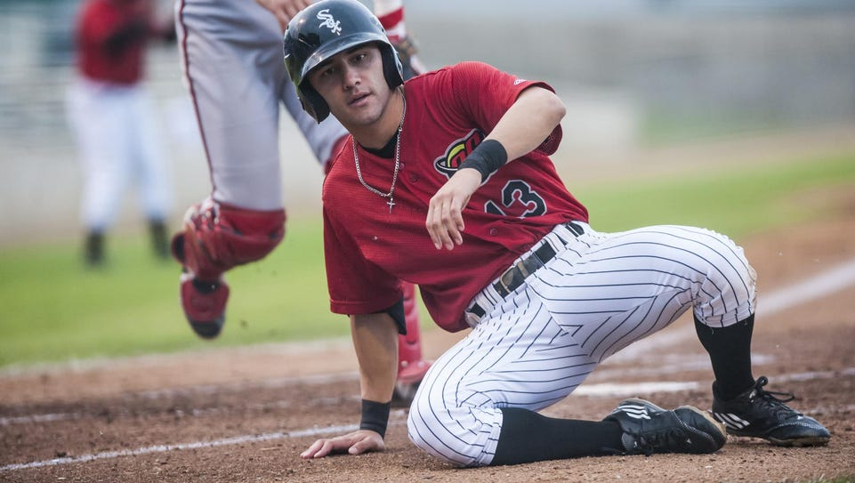 Frank Califano of the Voyagers slides home safely Tuesday