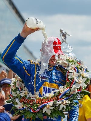 Alexander Rossi douses himself with milk during the celebration of his victory in the 100th running of the Indianapolis 500.