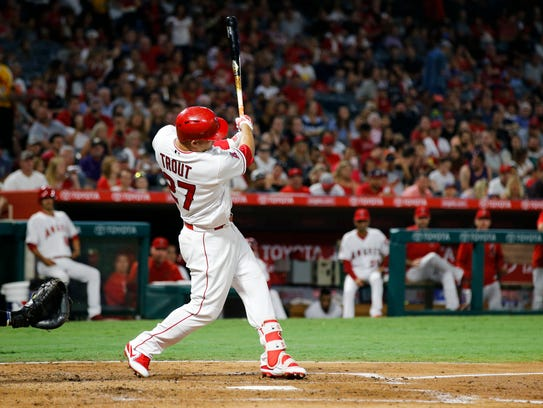 Los Angeles Angels' Mike Trout hits a double, the 1000th