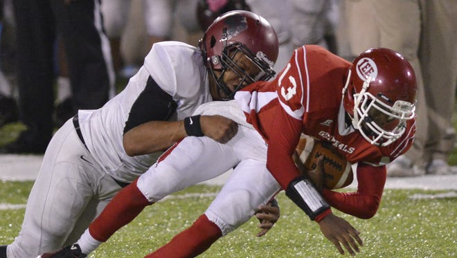 Prattville's Dytarious Johnson, left, tackles Shaquille Johnson on Oct. 24, 2014.