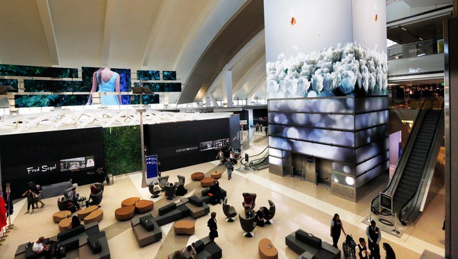 A multistory digital video display greets passengers in a waiting area at the Tom Bradley International Terminal, named for the late mayor of Los Angeles, at Los Angeles International Airport.