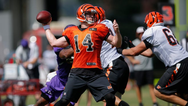 Cincinnati Bengals quarterback Andy Dalton (14) drops back to throw during joint practice between the Minnesota Vikings and Cincinnati Bengals, Thursday, Aug. 11, 2016, on the practice fields next to Paul Brown Stadium in Cincinnati.