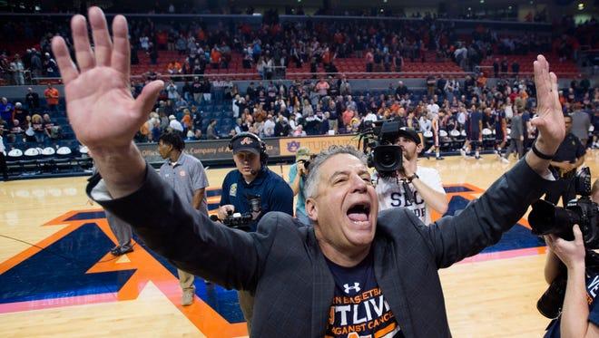 Auburn coach Bruce Pearl celebrates after Auburn defeated LSU 95-70 in an NCAA college basketball game Saturday, Jan. 27, 2018, in Auburn, Ala. (AP Photo/Albert Cesare)