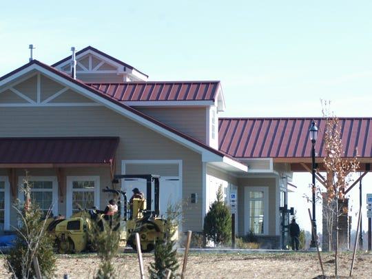 A crew continues to work on the new community center