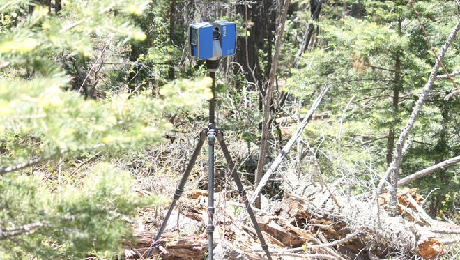 FARO 3-D imaging device is used to scan the area that Margaret C. Pointer's skeletal remains were found in 2004.
