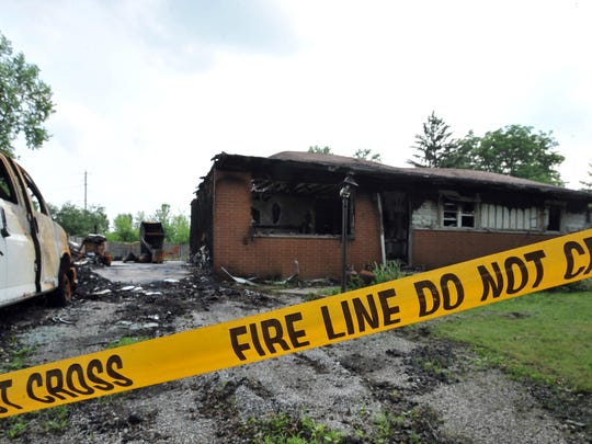 Leisa and John Marcum's home in Canal Winchester was consumed by flames during a June 1 fire. Leisa's son, Josh Coyle, and his girlfriend, Jessica Moore, were trapped in the basement during the fire.