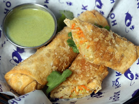 Spicy chicken egg rolls with mint yogurt dip at The Hook.