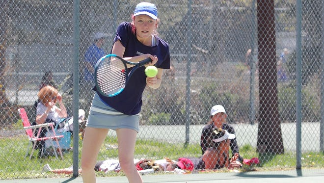 Poudre's No. 3 singles player Anna Hoffman during Friday's regional tennis action. Hoffman went on to win a regional title at No. 3 singles as the Impalas won the regional team title.