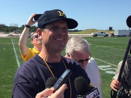 Michigan football coach Jim Harbaugh speaking to reporters on Feb. 29, 2016.