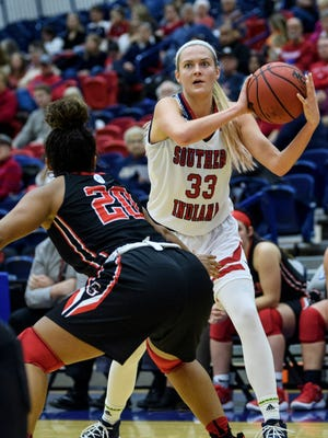 USI's Kaydie Grooms (33) makes a pass from the right wing during the second quarter against the Grace College Lancers at USI's Physical Activites Center in Evansville, Ind., Sunday, Dec. 31, 2017.