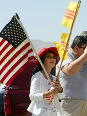 Ngan Nguyen pays her respects to Betty Ford as the former first lady's remains depart Palm Springs in 2011.