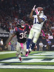 Indianapolis Colts T.Y. Hilton pulls in a third quarter touchdown pass in front of Houston Texans D.J. Swearinger. Indianapolis traveled to Houston for a Thursday night game October 9, 2014.