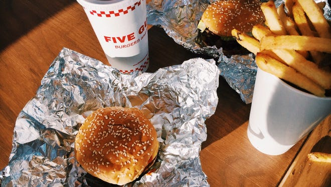 File photo of burgers and fries from Five Guys.