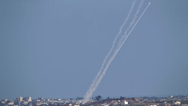 A rocket fired by Palestinian militants from inside the Gaza Strip makes its way toward Israel on July 16, 2014.