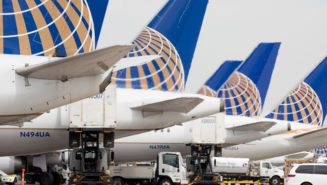 United Airlines planes are seen at Denver International Airport on May 7, 2017.