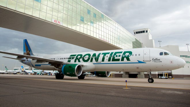 A Frontier Airbus A321 passes under the pedestrian bridge at  Denver International Airport on May 7, 2017.