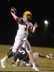 Smyrna's quarterback John Turner (18) passes the ball