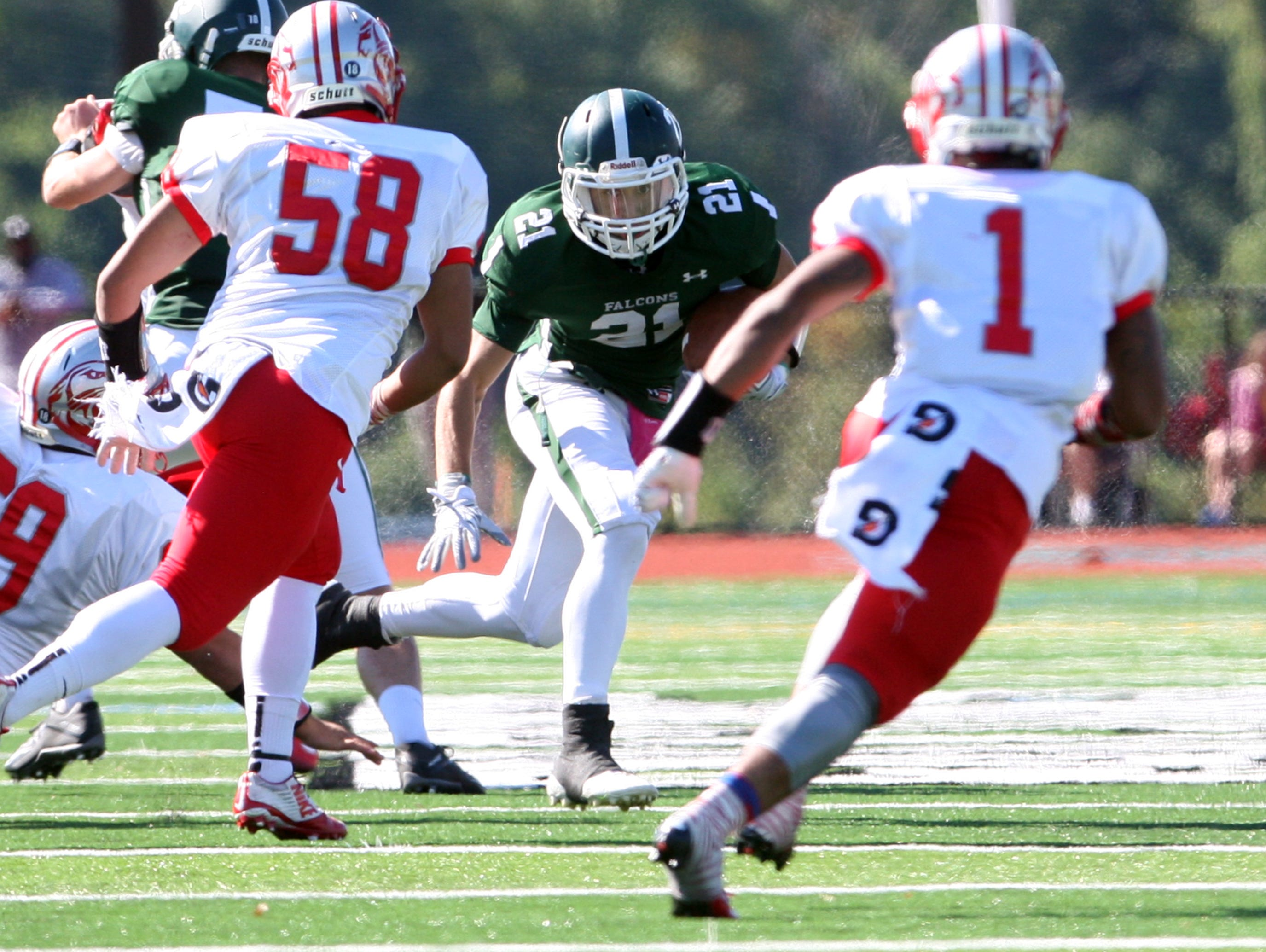 Action photos from the Perth Amboy High School at St. Joseph football game held at St. Joseph's new turf field in Metuhen on Saturday October 10, 2015. Here St. Joseph's (center) # 21 Emmanuel Resto looks for running room pas Perth Amboy defenders.