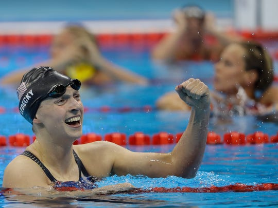 Katie Ledecky celebrates winning gold in the women's 200-meter freestyle.