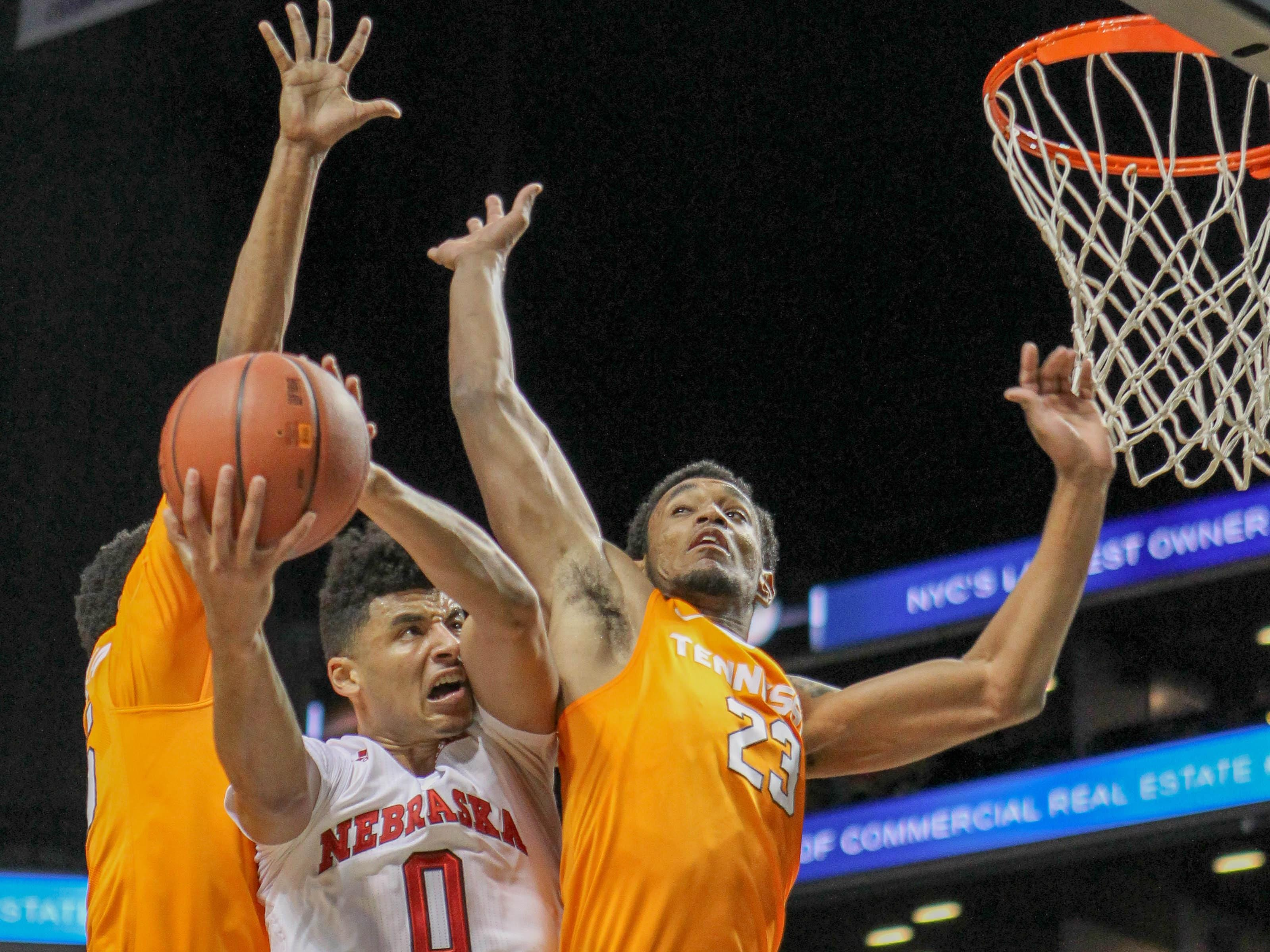 Nov 28, 2015; Brooklyn, NY, USA; Nebraska Cornhuskers guard Tai Webster (0) attempts to shoot past Tennessee Volunteers forward Derek Reese (23) during the consolation game at Barclays Center. Mandatory Credit: Vincent Carchietta-USA TODAY Sports