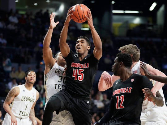 Louisville's Donovan Mitchell goes up for a shot against