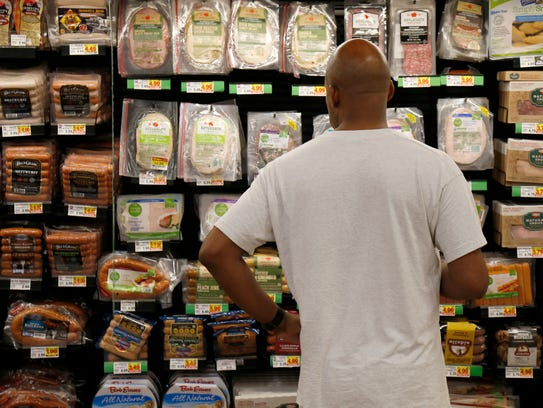 Neal Williams, of Clifton, browses Kroger's Simple