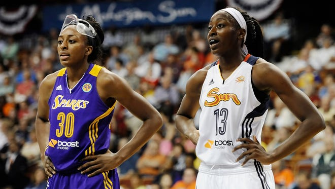 Los Angeles Sparksí Nneka Ogwumike, left, stands with her sister Connecticut Sunís Chiney Ogwumike, during the first half of a WNBA basketball game between the two teams.