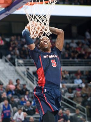 Pistons' Kentavious Caldwell-Pope dunks in the third quarter for two of his game-high 21 points.