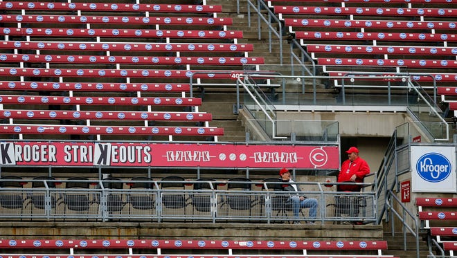 Most of the left field upper deck remains empty during the top of the third inning of the MLB National League game between the Cincinnati Reds and the Atlanta Braves at Great American Ball Park in downtown Cincinnati on Monday, April 23, 2018.