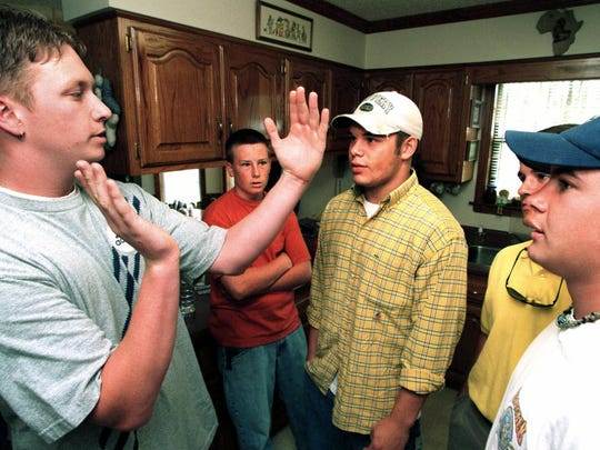 Barrett Baber, left, talks with friends and relatives