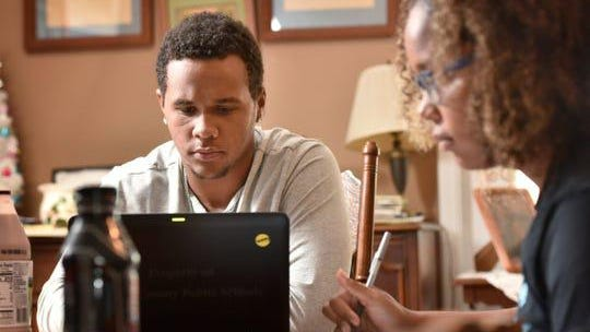 Ty Jackson, 18, studies with his sister Ellie, 15, at their home during the coronavirus pandemic April 16 in Jacksonville, Fla.