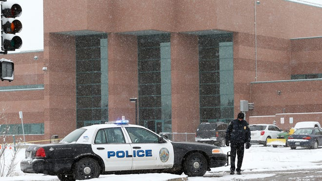 A police cruiser blocks the entrance to Standley Lake High School in Westminster, Colo., where classes were canceled after a student's apparent suicide attempt Jan. 27, 2014. Police say a 16-year-old boy was critically injured after setting himself on fire at the suburban Denver high school.