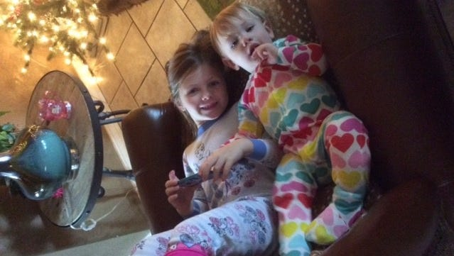 Landrie and Saylor Click smile at their grandmother, Diana McCullough, on a lazy afternoon.