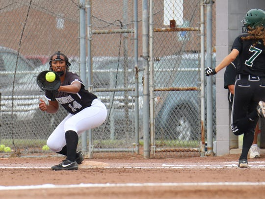 Catching the throw to first to retire an Allen Park