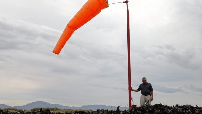 Airport Manager Bill Provance stands in the 90-foot circle surrounding the airport windsock at Doña Ana County International Jetport in Santa Teresa. The circle can now be spotted easily from the sky since it is filled with several tons of black shredded tires.
