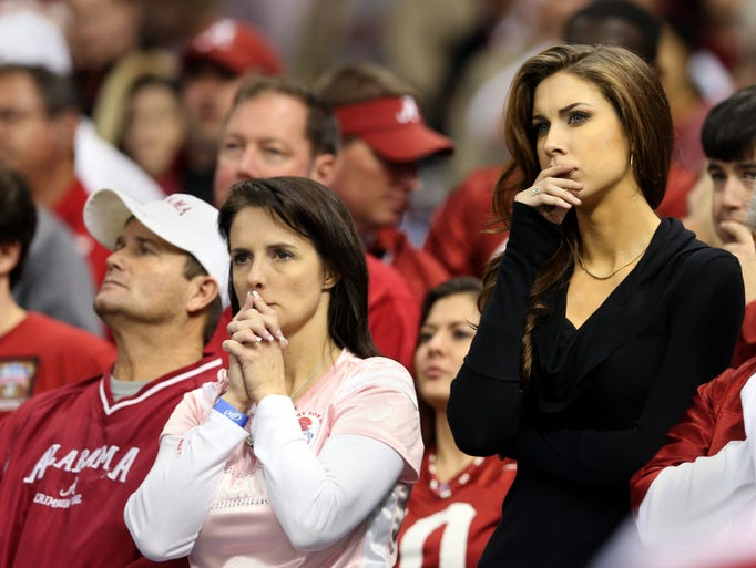 Alabama Crimson Tide quarterback AJ McCarron's mother, Dee Dee McCarron (left) and girlfriend, Katherine Webb (right) watch his team fall behind against the Oklahoma Sooners during the second half of the Sugar Bowl at the Mercedes-Benz Superdome. Oklahoma won, 45-31.