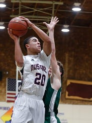 Tulare Western's Ira Porchia drives to the basket during