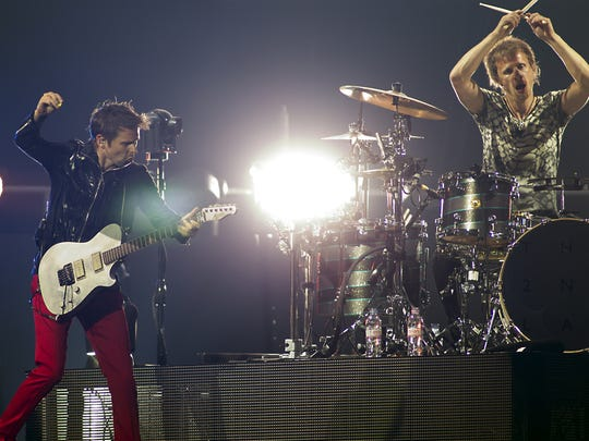 Guitarist and singer Matthew Bellamy (left) and drummer Dominic Howard (right) of the English rock band Muse perform in Amsterdam in 2013.