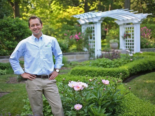 Jonathan Wright, Ruth Lilly deputy director for horticulture and natural resources, stands in the RD Wood Formal Garden at the Indianapolis Museum of Art.
