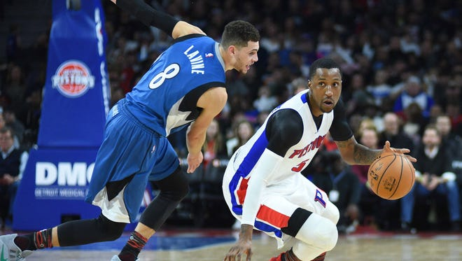Pistons guard Kentavious Caldwell-Pope (5) dribbles the ball past Timberwolves guard Zach LaVine (8) during the second quarter of the Pistons' win Friday at the Palace.
