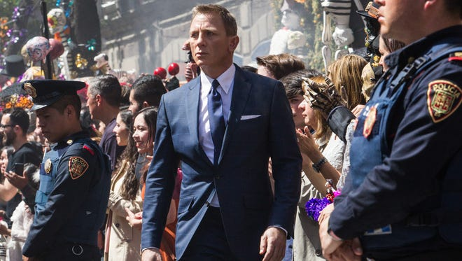 """Daniel Craig's newest outing as 007 begins the streets of Mexico City during a Dia de los Muertos procession in """"Spectre."""""""