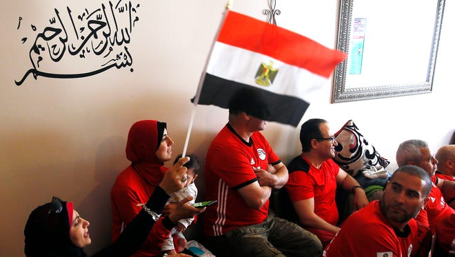 Marwa Ramadan of Rockaway waves the Egyptian flag as about 50 friends and family with Egyptian ties packed the home of Mokhtar and Amany Elhendy in Hanover Twp. to cheer on Egypt's national soccer team, known as The Pharaohs, in the 2018 World Cup. June 15, 2018. Cedar Knolls, NJ