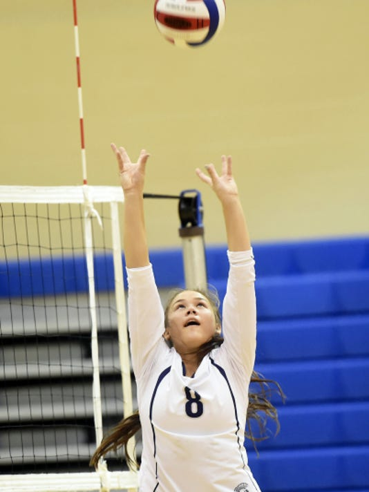 Chambersburg's Lauren Ching sets a ball for teammates against Carlisle on Thursday. The Trojans won the first two sets but suffered a 3-2 loss.