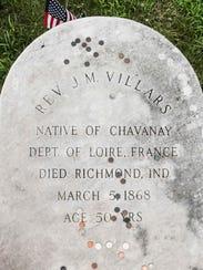 The grave of Rev. John Baptist Villars, covered in