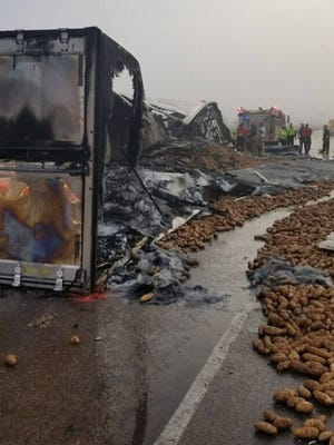 An 18-wheeler carrying a load of potatoes overturned and caught fire on Interstate 10 Monday morning. Officials say the crash was fatal.