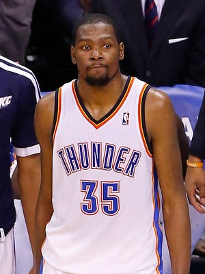 A dejected Kevin Durant watches the final seconds tick down on the Thunder's season-ending loss.
