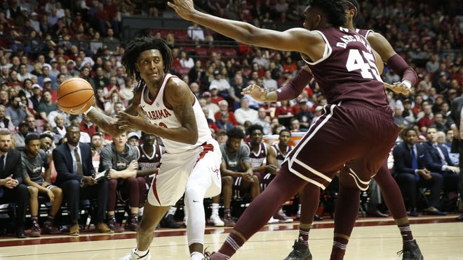Alabama guard John Petty (23) fires a hard pass along the baseline past Mississippi State center E.J. Datcher (45) in Coleman Coliseum Saturday, Jan. 20, 2018.