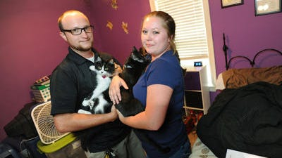Tabitha Hewitt, her boyfriend Kenneth Lee Owen, and their two cats, Freya, left, and Dante, have been living back with Tabitha's parents since all four survived the April 28 tornado that destroyed their mobile home in Pearl.
