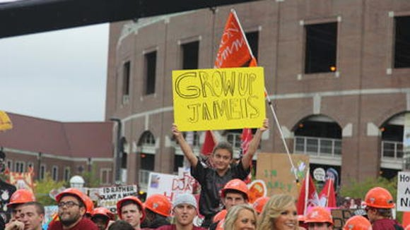 "A fan holds up a sign that says ""Grow up Jameis"" at ESPN's College GameDay before the FSU-Clemson game. Jameis Winston was benched for the game for ""offensive and vulgar"" language he used in the FSU Student Union."